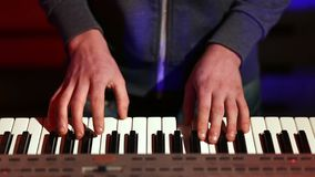 Man hands playing electronic keyboard on stage stock video