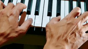 Man hands playing piano. Close-up hands of musician who plays keyboards. Male hands playing synthesizer digital piano. Man hands playing digital lifestyle piano stock footage