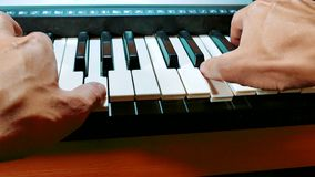 Man hands playing piano. Close-up hands of musician who plays keyboards. Male hands playing synthesizer digital piano. Man hands playing lifestyle digital piano stock video footage