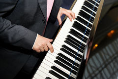 Man hands playing piano Stock Photo