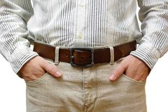 Man with hands in pockets Stock Images