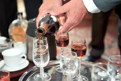 Man hands pouring drink Stock Photos