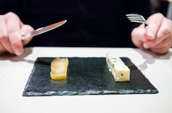 Man hands preparing to eat amuse bouche in a restaurant Stock Photos