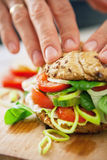Man hands prepearing sandwich closeup image Royalty Free Stock Photography