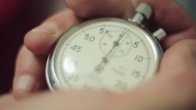 Man hands push button of old round stopwatch. Close up.  stock video