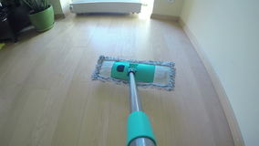 Man hands put wet mop on broom and wash dust from wood floor. 4K stock footage