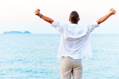 Man with hands raised  the beach Royalty Free Stock Photo