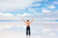 Man with hands raised Stock Images