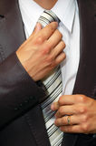 Man Hands Remedying Tie Royalty Free Stock Images