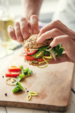Man hands with sandwich Stock Images