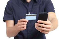 Man hands shopping on the smart phone with a credit card Stock Photo