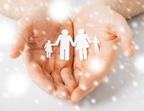 Man hands showing family of paper people Stock Photos