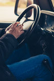 Man hands with smartphone in car Stock Photos