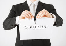 Man hands tearing contract paper Royalty Free Stock Photo