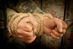 Man with hands tied with rope Royalty Free Stock Photo