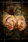 Man with hands tied with rope Stock Image