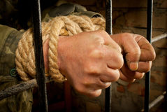 Man with hands tied with rope Stock Photo