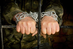 Man with hands tied up with chain Royalty Free Stock Photo