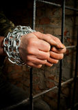 Man with hands tied up with chains Stock Images