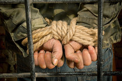 Man with hands tied up with rope Royalty Free Stock Images