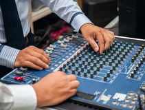 Man hands tuning of sound mixer Stock Images