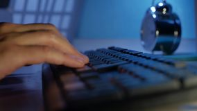 Man hands typing on a computer keyboard. Close up man hands is typing on keyboard. Man hands typing on computer keyboard. Close up man hands is typing on stock footage