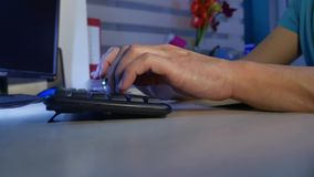 Man hands typing on a computer keyboard. Close up man indoors hands is typing on keyboard. Man hands typing on computer keyboard. Close up man indoors hands is stock video footage