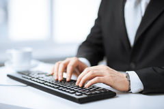 Man hands typing on keyboard. Picture of man hands typing on keyboard Royalty Free Stock Photography