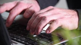 Man hands typing on a keyboard, close-up. Man hands typing on a laptop keyboard, close-up stock footage