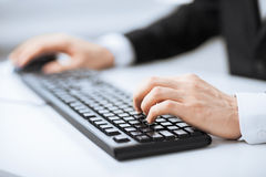 Man hands typing on keyboard. Picture of man hands typing on keyboard stock image