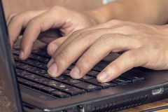 Man hands typing on laptop. Close up of business man hands typing on laptop computer, business concept stock photography
