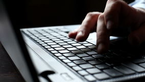 Man hands typing on a laptop keyboard. Man hands typing on a keypad on laptop keyboard stock footage