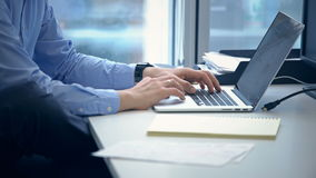 Man hands typing on laptop keyboard. Stock footage of business person working with laptop stock footage