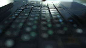 Man hands typing text on laptop keyboard, font printing. Close-up with smooth rotation stock footage