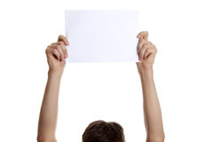 Man hands up with blank sheet  Stock Image