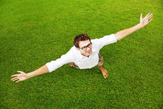 Man with hands up in a field Royalty Free Stock Photos