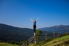 Man with hands up on top of mountains Royalty Free Stock Photos