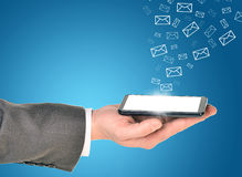 Man hands using smart phone with flying envelopes Royalty Free Stock Image