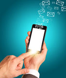 Man hands using smart phone with flying envelopes Royalty Free Stock Photo