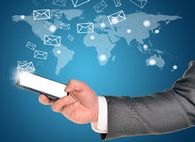 Man hands using smart phone with flying envelopes Royalty Free Stock Images