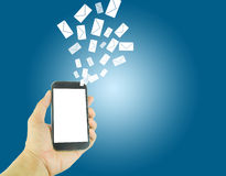 Man hands using smart phone with flying envelopes. Royalty Free Stock Photo