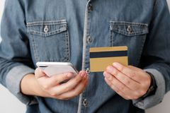 Man hands using smart phone and holding credit card, shopping on. Line concept, mobile banking, business and technology Royalty Free Stock Images