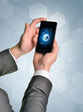 Man hands using smart phone. Image of Earth on Royalty Free Stock Photos