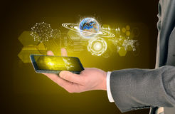 Man hands using smart phone. Image of world map on Royalty Free Stock Images
