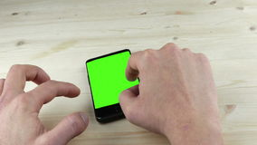 Man hands using a smart phone for write text messaging with chroma key, green screen, communication with smartphone technology stock video
