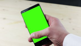 Man hands using a smart phone for write text messaging with chroma key, green screen on white background stock video footage