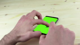 Man hands using a smart phone for write text messaging with chroma key, green screen on white background stock video