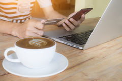 Man hands using smartphone laptop and holding credit card with s. Ocial media as Online shopping concept Stock Photos