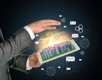 Man hands using tablet pc. Business city on touch. Screen. Business concept Royalty Free Stock Photo