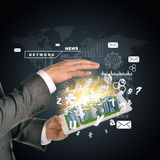 Man hands using tablet pc. Business city on touch. Screen. Business concept Royalty Free Stock Images
